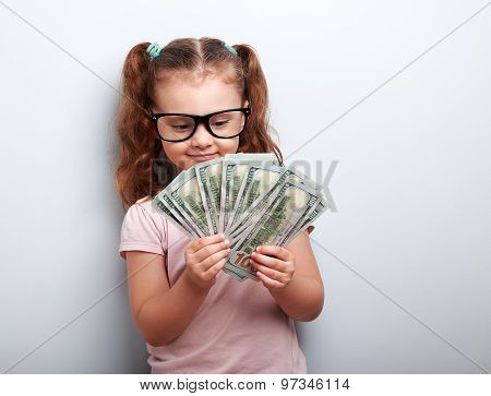 Happy Kid Girl In Glasses Looking On Money And Counting The Profit