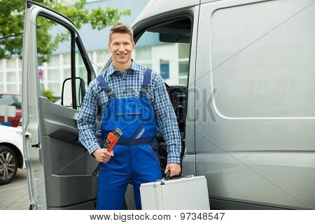 Worker With Work Tool And Toolbox