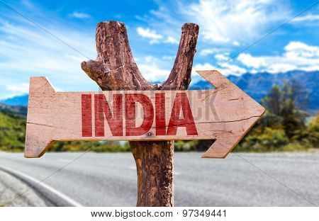 India wooden sign with road background