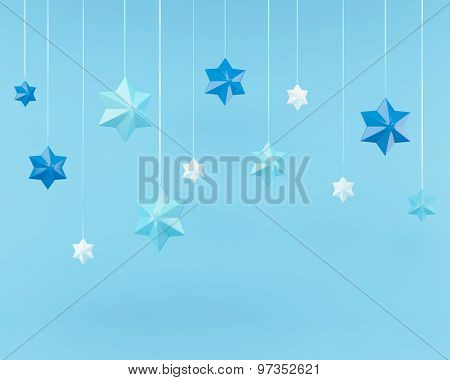 Snowflakes And A Garland Of 3D Stars On Blue Background With Clipping Path