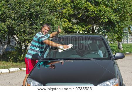 driver washing a car