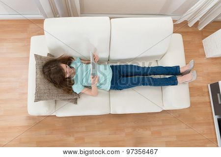 Girl On Sofa Using Digital Tablet