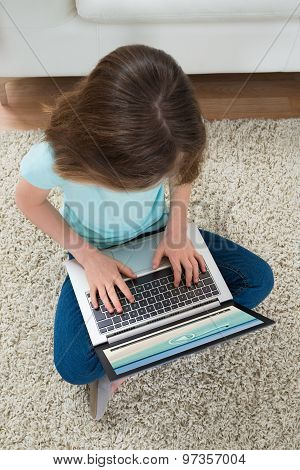 Girl Looking At Video On Laptop