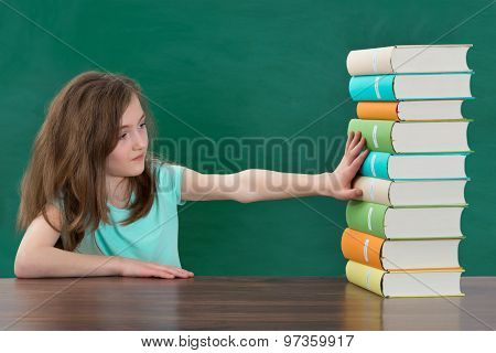 Girl Touching Stack Of Books