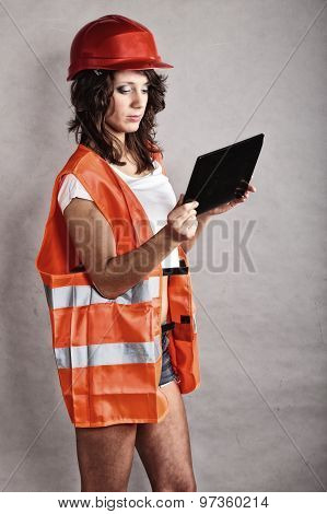 Sexy Girl In Safety Helmet Using Tablet Touchpad
