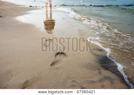Woman's Footprints On The Seashore