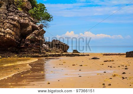 Unique Andaman Sea. Rocks of the island in the shallow waters and beautiful beaches with fine  sand