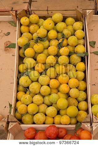 Fresh Yellow Plums In A Market.