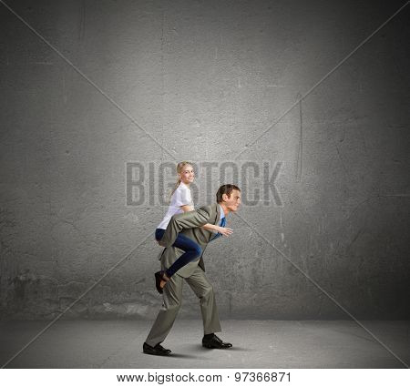 Young girl riding on back of her man