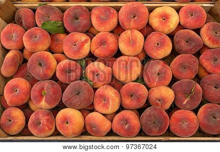 Fresh Saturn Peaches In A Market.
