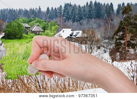 Hand Deletes Winter Village By Rubber Eraser