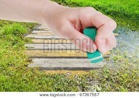 Hand Deletes Green Swamp By Rubber Eraser