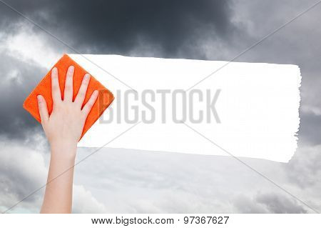 Hand Deletes Rainy Clouds From Sky By Orange Rag