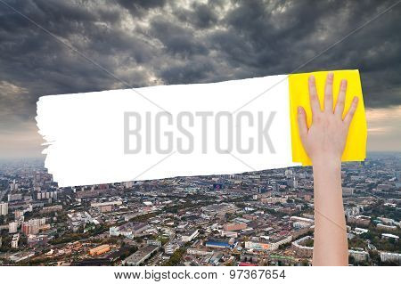 Hand Deletes Storm Clouds Over City By Yellow Rag