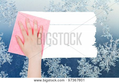 Hand Deletes Winter Snowflake On Window By Rag