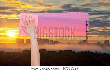 Hand Deletes Yellow Sunrise Sky By Pink Cloth