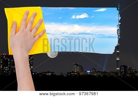 Hand Deletes Night Over City By Yellow Cloth