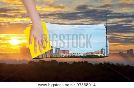Hand Deletes Yellow Sunrise Over City By Cloth