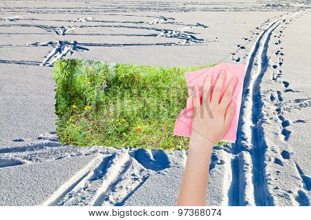 Hand Deletes Snow Fileld With Ski Tracks By Cloth
