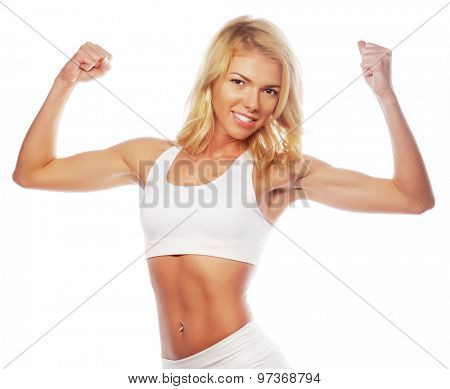 sporty woman is showing her strong hands on white background