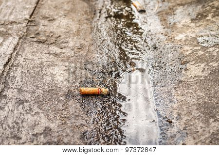 Cigarette Butts On Dirty Floor