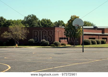 Basketball hoop outside a school