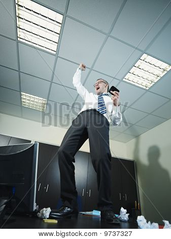 Businessman Having Good News On The Phone