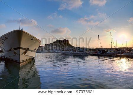Denia port sunset dusk in marina at Alicante Mediterranean Spain