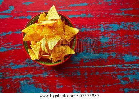 Nachos mexican food tortilla on red grunge background
