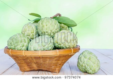 Custard Apples With Basket On Old Wooden Table