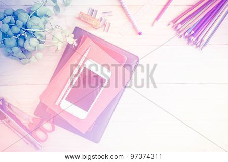 Abstract Blurred Cluttered Office Desk Background With Color Filters.