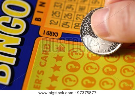 Coquitlam BC Canada - June 02, 2015 : Woman scratching lottery tickets. The British Columbia Lottery Corporation has provided government sanctioned lottery games in British Columbia since 1985.