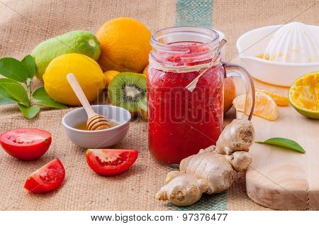 Freshly Tomato Juice With Tomato Slice, Ginger ,oranges , Honey ,kiwi ,mint And Orange Juice Set Up