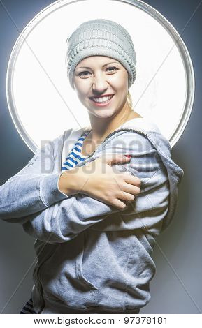 Fashion Concepts. Portrait Of Extravagant Young Caucasian Female In Warm Hat Wearing Hoody Jacket. H