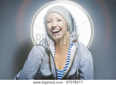 Fashion Concepts. Portrait Of Laughing Extravagant Young Caucasian Female In Warm Hat Wearing Hoody