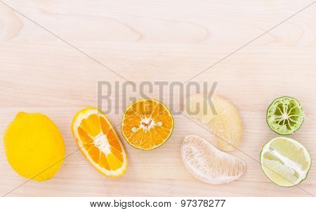 Mixed Citruses Fruit Oranges, Pomelo , Lemon And Lime On Wooden Background .