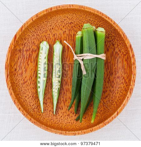 Lady 's Fingers Or Okra Clean And Healthy Food On White Table .