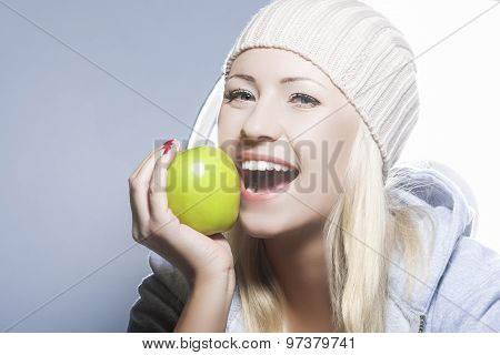Healthy Lifestyle Concept. Portrait Of Smiling Caucasian Woman With Green Apple