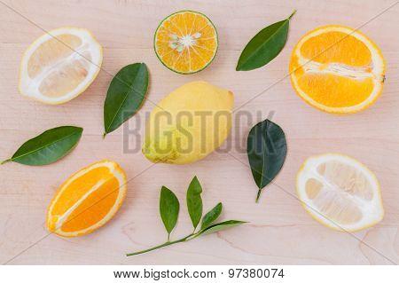 Mixed Citruses Fruit Oranges, Lemon On Wooden Background With Orange Leaf.