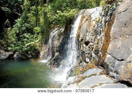 A small waterfall in the tropical jungle. Philippines. Palawan.