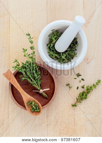Bunch Of Fresh Organic Thyme In White Mortar On Wooden Background