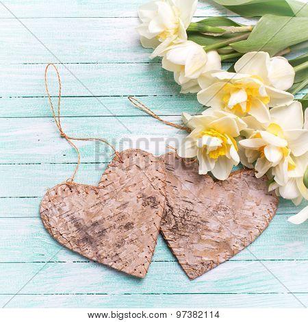 Bright White Daffodils And Two Decorative Hearts
