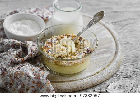 Cottage Cheese Casserole With Apples In A Glass Bowl On A Light Wooden Background