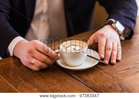 coffee cup in hands