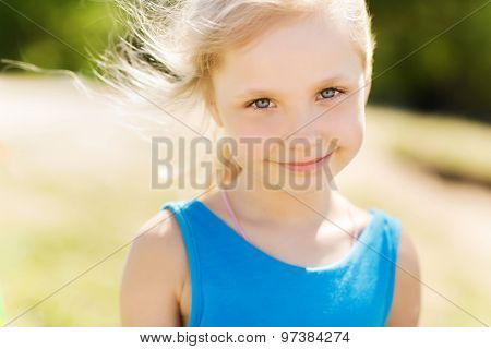 summer, childhood, leisure and people concept - happy little girl outdoors