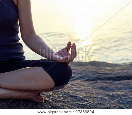 The Woman Meditating In A Yoga Pose On The Tropical Beach.