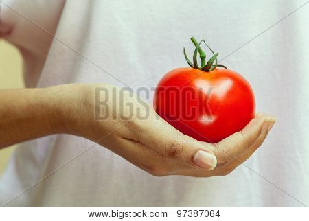 The Girl Holding Tomato. - Healthy Food Concept.