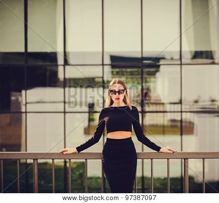 Confident Woman On The Background Of An Office Building