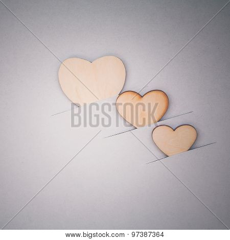 The Wooden Hearts On Cardboard Background. - Concept For Love And Wedding .