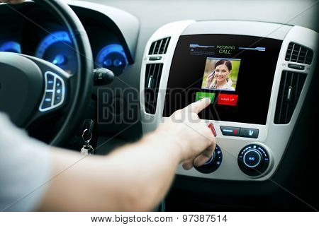 transport, modern technology, communication and people concept - male hand pushing button and receiving video call from woman on car panel screen